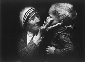 An undated file picture shows Blessed Teresa of Kolkata holding a child during a visit to Warsaw, Poland. Mother Teresa will be canonized by Pope Francis Sept. 4 at the Vatican. (CNS photo/Tomasz Gzell, EPA)